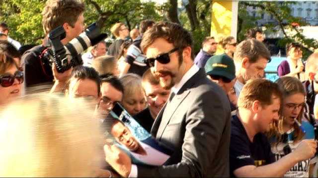 red carpet arrivals; christine bleakley talking to press / chris o'dowd signing autographs / bleakley talking to other crews sot - christine bleakley stock videos & royalty-free footage