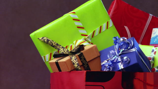 cu, pan, bag full of christmas presents - christmas gift stock videos & royalty-free footage