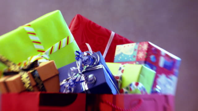 cu, zi, bag full of christmas presents - wrapping paper stock videos & royalty-free footage