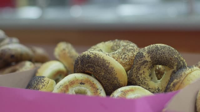 bagels for everyone with donuts - doughnut stock videos & royalty-free footage
