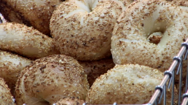 cu tu bagels for sale at street stall / new york, united states - bagel stock videos & royalty-free footage