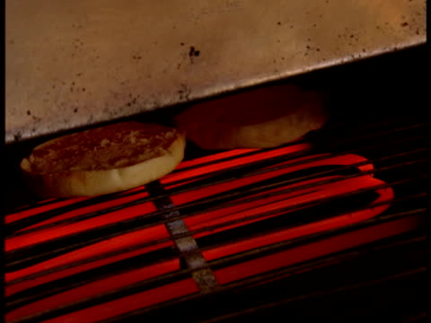 * handheld bagels toasting on grill in restaurant breakfast morning diner food meal - bagel stock videos & royalty-free footage