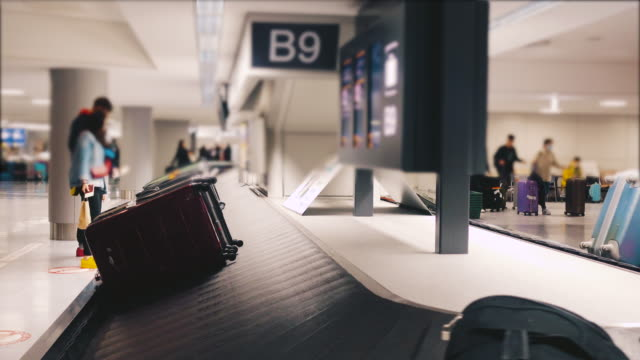 baggage belt - airport stock videos and b-roll footage