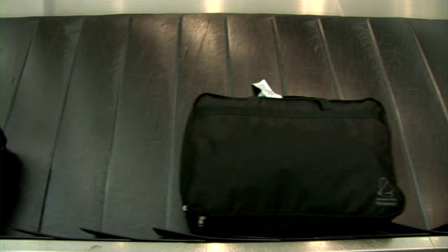 hd: baggage carousel - baggage claim stock videos and b-roll footage