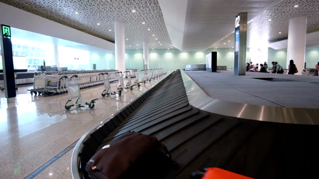 baggage carousel - baggage claim stock videos and b-roll footage