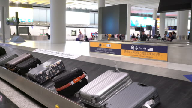 baggage carousel - hong kong international airport stock videos and b-roll footage