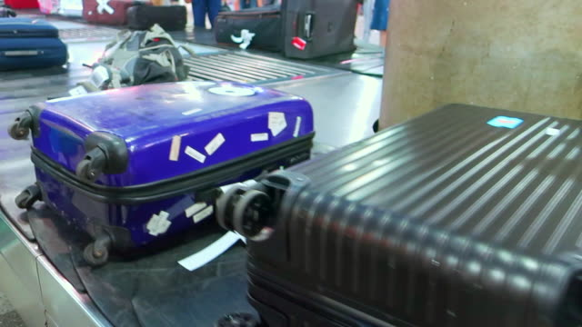 baggage claim belt - suitcase stock videos & royalty-free footage