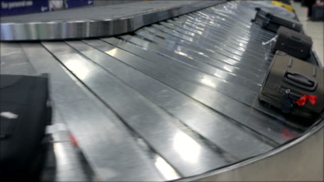 Baggage conveyor belt in the  Airport carrying the passenger luggage.