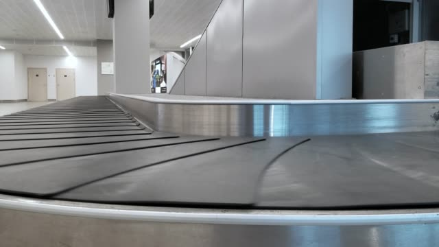 baggage is lost. the empty moving luggage carousel in the airport - luggage stock videos & royalty-free footage