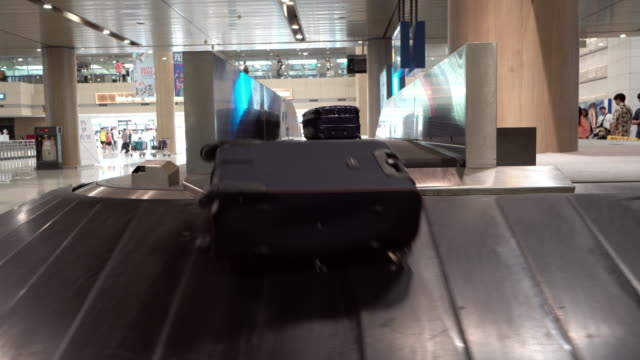 baggage moved in the airport - arrival stock videos & royalty-free footage