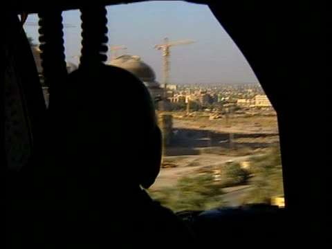 Baghdad Apache military helicopters flying towards to land as transporting Prime Minister Tony Blair to Baghdad for surprise visit BV Soldier...