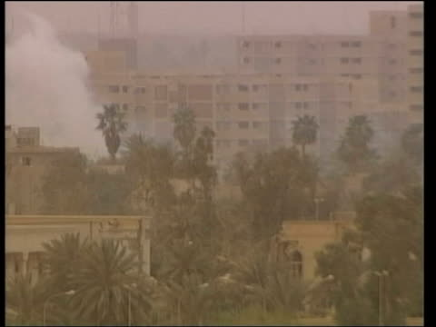 baghdad ext tgvs smoke rising from buildings on riverbank as blasts from tank fire heard sot ls explosion from tank fire hitting building behind... - 2003 stock-videos und b-roll-filmmaterial