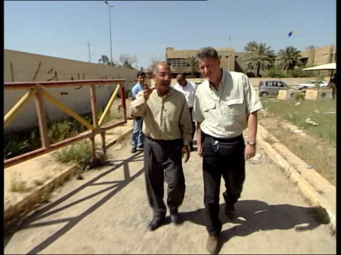 baghdad int bv feet of us soldier and others along as williams escorted to location of documentation relating to saddam hussein's regime gv files... - interrogation stock videos & royalty-free footage