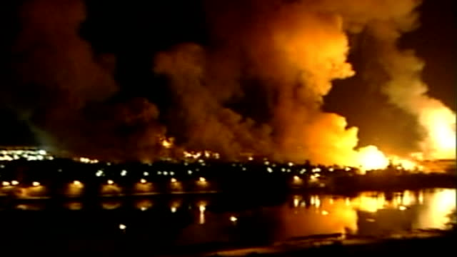 baghdad: night buildings exploding into flames and smoke rising into air during 'shock and awe' bombing of baghdad by us forces - shock stock videos & royalty-free footage