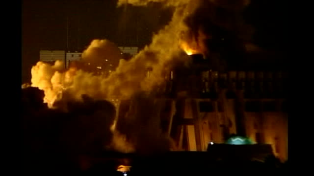 baghdad buildings exploding into flames and smoke rising into air during 'shock and awe' bombing of baghdad by us forces night - shock stock videos and b-roll footage