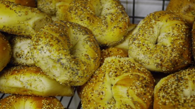 bagles on the tray in yorkville, new york - bagel stock videos & royalty-free footage