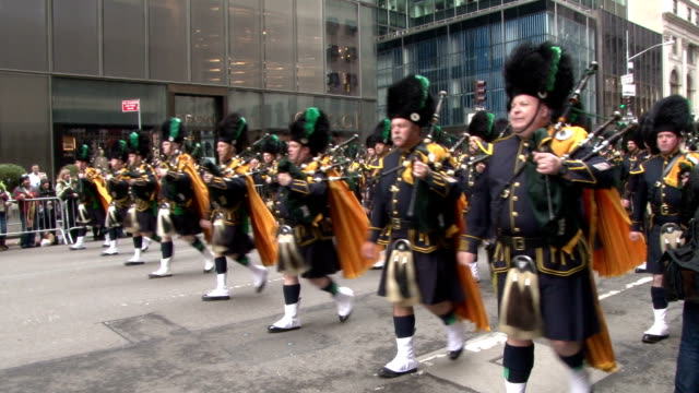 bagpipers march down 5th avenue in nyc during the 2015 st. patrick's day parade. - bagpipes stock videos & royalty-free footage