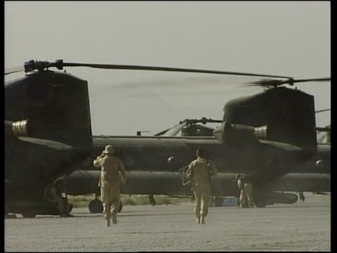bagram air base us soldiers along at airbase soldier sitting on helicopter loading bay - bagram air base stock videos & royalty-free footage