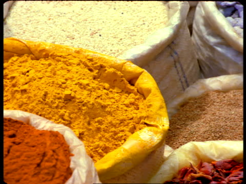 bags display colorful indian spices. - season stock videos & royalty-free footage