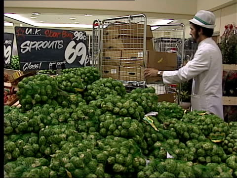 int bags of brussel sprouts on display in supermarket supermarket worker adding bags of sprouts to pile - brussels sprout stock videos & royalty-free footage