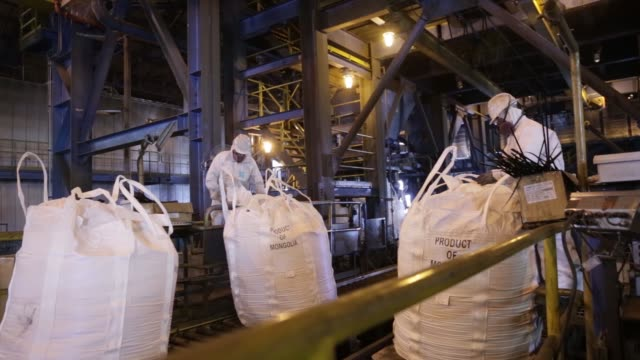 Bags of copper gold concentrate move along a conveyor in the bagging plant at the Oyu Tolgoi copper gold mine jointly owned by Rio Tinto Group's...