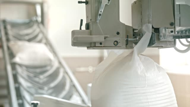 bags of flour stitched on the conveyor - bag stock videos & royalty-free footage