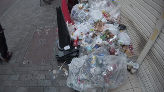 bags of rubbish and garbage along a shibuya street - dustbin stock videos & royalty-free footage