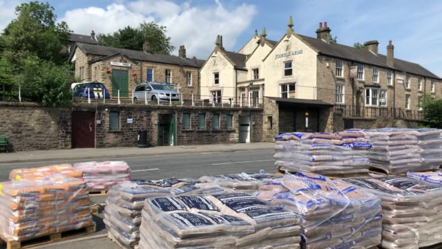 bags of sand are stacked on the deserted streets within the closed off village of whaley bridge below toddbrook reservoir on august 03 2019 in whaley... - sandbag stock videos & royalty-free footage