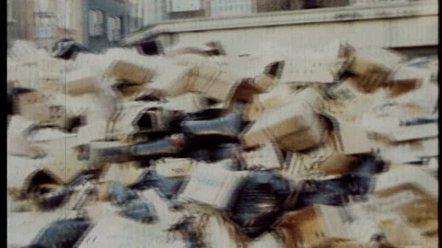bags of uncollected rubbish piled up in street during 'winter of discontent' man spraying disinfectant on rubbish stacks of uncollected rubbish left... - 1979 stock videos and b-roll footage