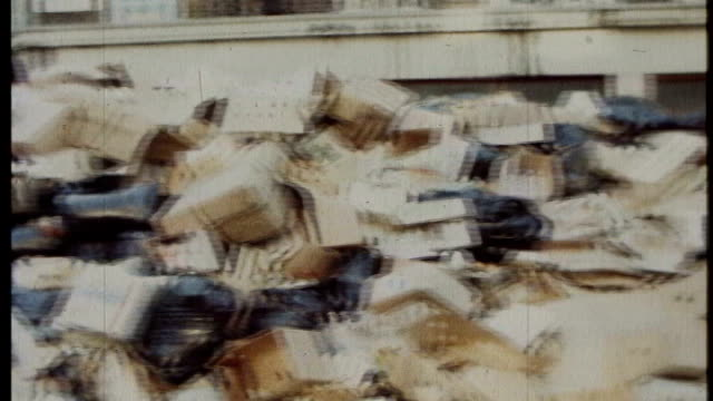 bags of uncollected rubbish piled up in street during 'winter of discontent' man spraying disinfectant on rubbish stacks of uncollected rubbish left... - 1979 stock videos & royalty-free footage