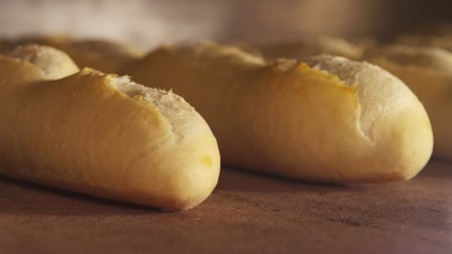 a baguette being baked and rising in the oven - bread stock videos & royalty-free footage