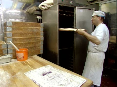baguettes prepared in bakery - french food stock videos & royalty-free footage
