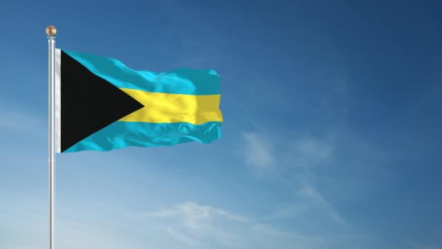 4k bahamas flag - loopable - bahamas stock videos & royalty-free footage