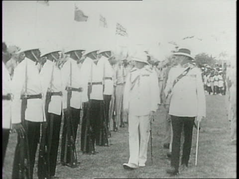 bahamian native troops veterans families and children gather in stands and walk alongside the duke and duchess of windsor / the couple on a platform... - young war veteran stock videos & royalty-free footage