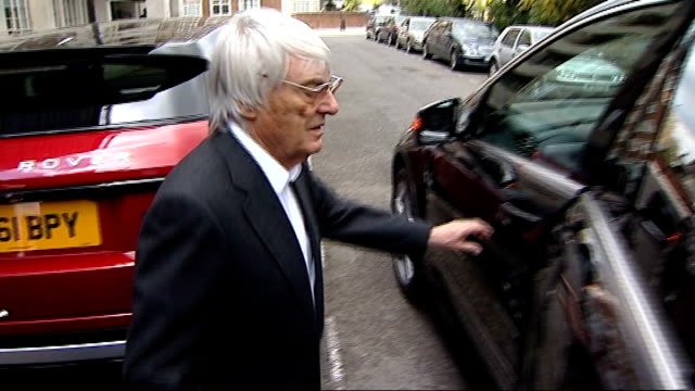 bahrain f1 grand prix may not go ahead in 2012; england: london: ext bernie ecclestone out of building - asked by reporter whether he thinks the... - bernie ecclestone stock videos & royalty-free footage