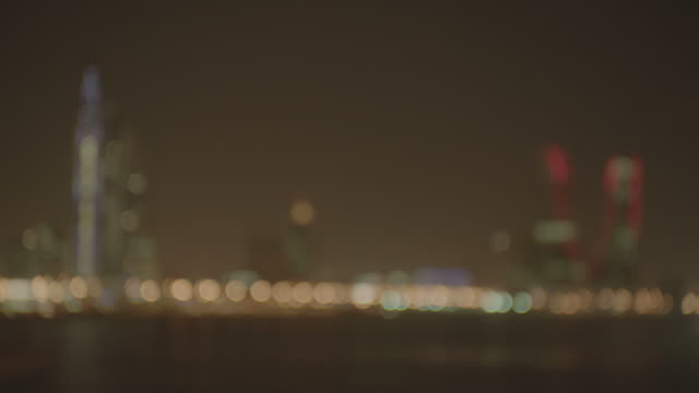 bahrain financial harbour skyline at night wide rackfocus on the illuminated skyline of the bahrain financial harbour district - panoramic stock videos & royalty-free footage
