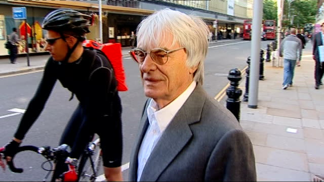 bahrain grand prix: bernie ecclestone interview; england: london: kings road: ext bernie ecclestone along street towards camera bernie ecclestone... - bernie ecclestone stock videos & royalty-free footage