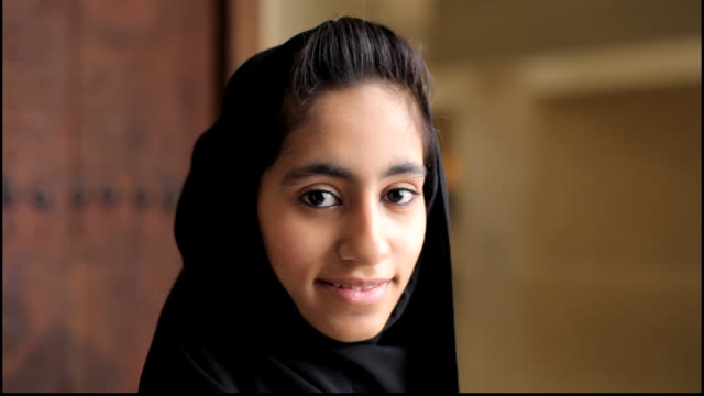 bahrain portrait. portrait of a young bahraini woman in traditional hijab turning from profile to face the camera with a small diffident smile on her... - profile stock videos & royalty-free footage