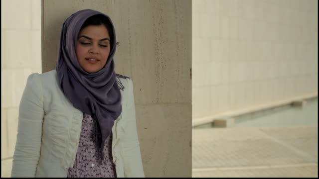 bahrain portrait. view of a pretty woman wearing a head scarf. she represents the ambitious spirit of entrepreneurship in the new generation. - profile stock videos & royalty-free footage