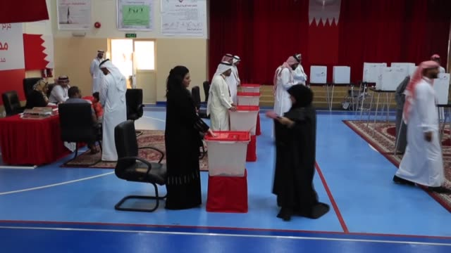 bahraini voters cast ballot on saturday in the gulf country's parliamentary and municipal election polling stations opened at 800 am local time and... - cast member stock videos and b-roll footage
