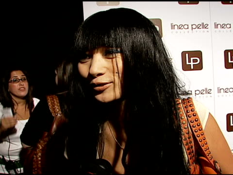 vídeos de stock, filmes e b-roll de bai ling on her hair extension, on the linea pelle line, on being the celebrity representative for the belt company at the linea pelle 20th... - bai ling