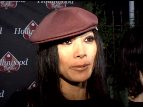 vídeos de stock, filmes e b-roll de bai ling on what is so cool about poker, on growing up with poker in china, on the benefits of online games at the hollywoodpoker com sees 1-year and... - bai ling