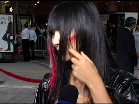 vídeos de stock, filmes e b-roll de bai ling talks about her upcoming projects at the 'mr and mrs smith' world premiere at the mann village theatre in westwood california on june 7 2005 - bai ling