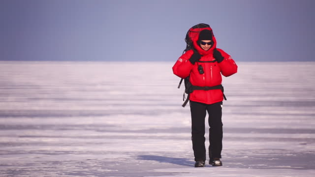 Baikal. A lone traveler with a backpack.