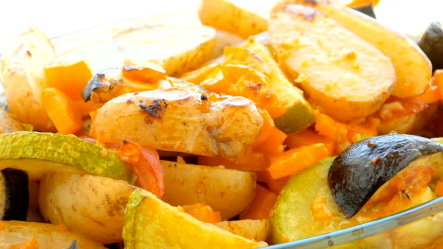 baked potato, carrots, zucchini slices in the peel, closeup - baked potato stock videos & royalty-free footage