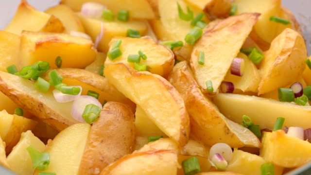 baked potato sliced with parsley, green onion, onion - parsley stock videos and b-roll footage