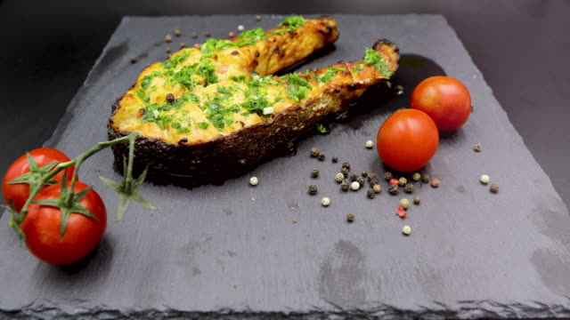 baked salmon steak isolated on black background - salmon steak stock videos & royalty-free footage
