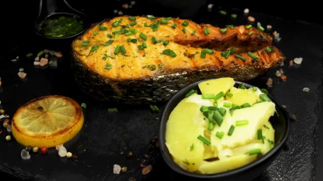 baked salmon steak isolated on black background - salmon salad stock videos & royalty-free footage