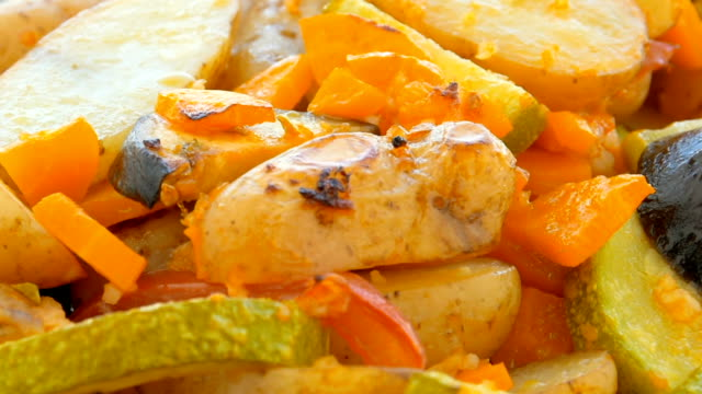 baked sliced potato, carrots, zucchini closeup - raw potato stock videos & royalty-free footage