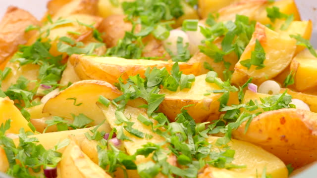 baked sliced potatoes with parsley, green onion, onion - parsley stock videos and b-roll footage